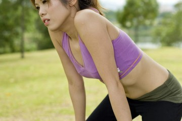 woman suffering from exhaustion while exercising