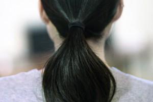 black hair in ponytail