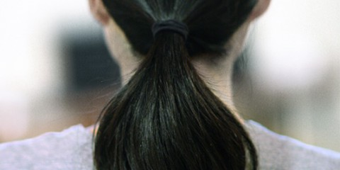 black hair in ponytail