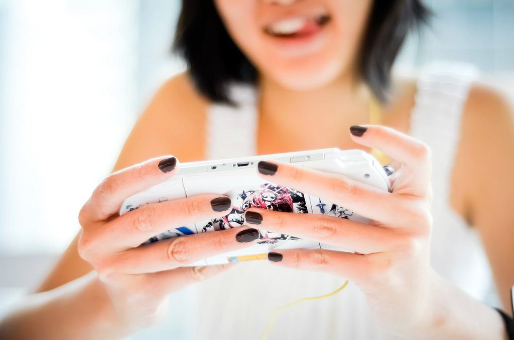 Girl playing games on a PSP