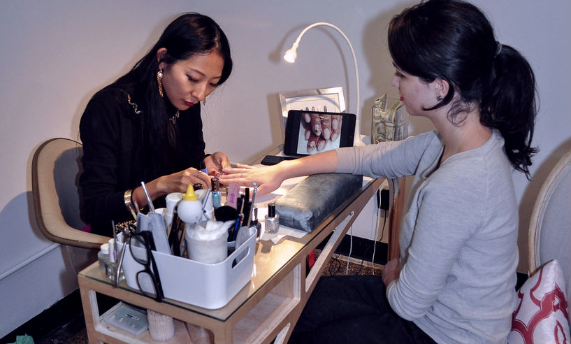 Girl getting manicure