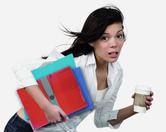 A woman with paperwork and coffee tripping