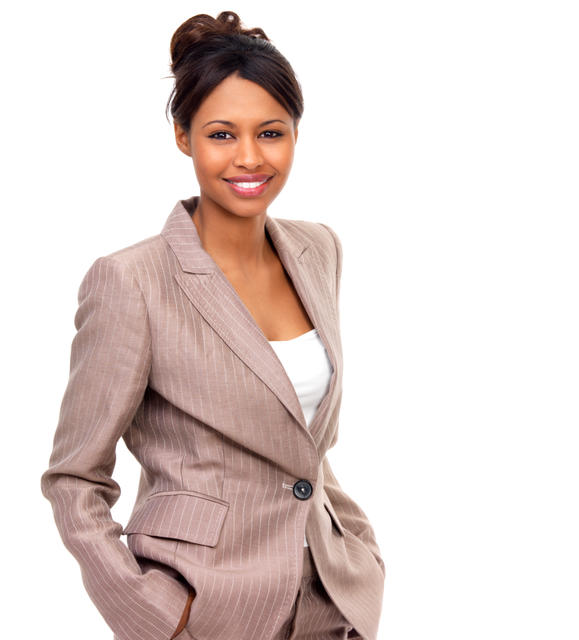 Portrait of a business woman with hands in pockets standing against white background