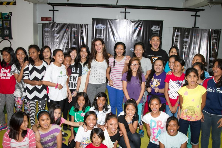 Miesha Tate with her self-defense class students during her trip to Manila