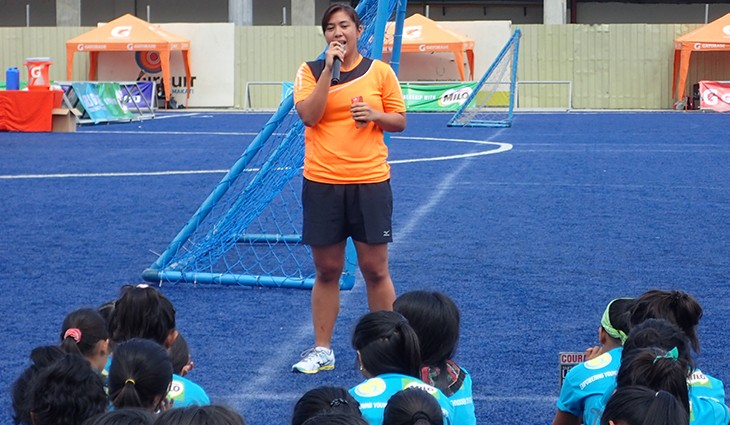 Marielle tells preteen girls about her experiences as an athlete at the first Girls Got Game sports camp. Photo by the author.