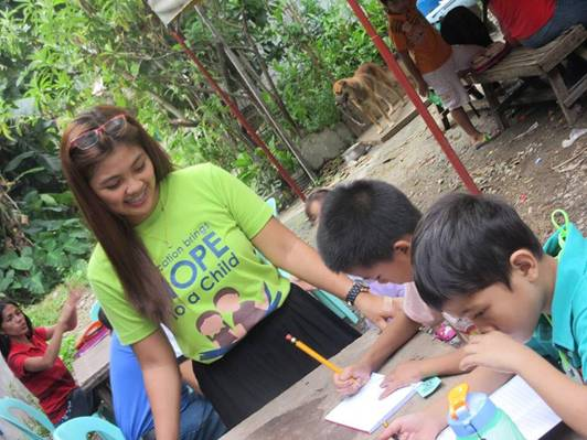 A Smiling Volunteer with Kids