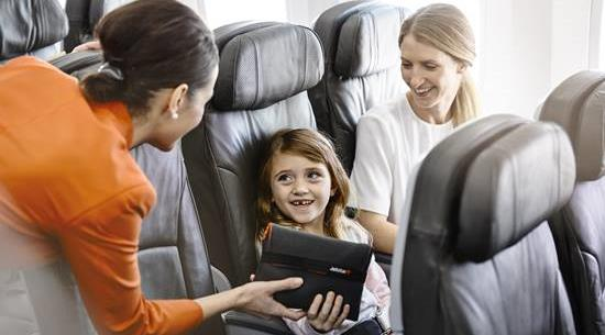 Jetstar crew member accommodating guests