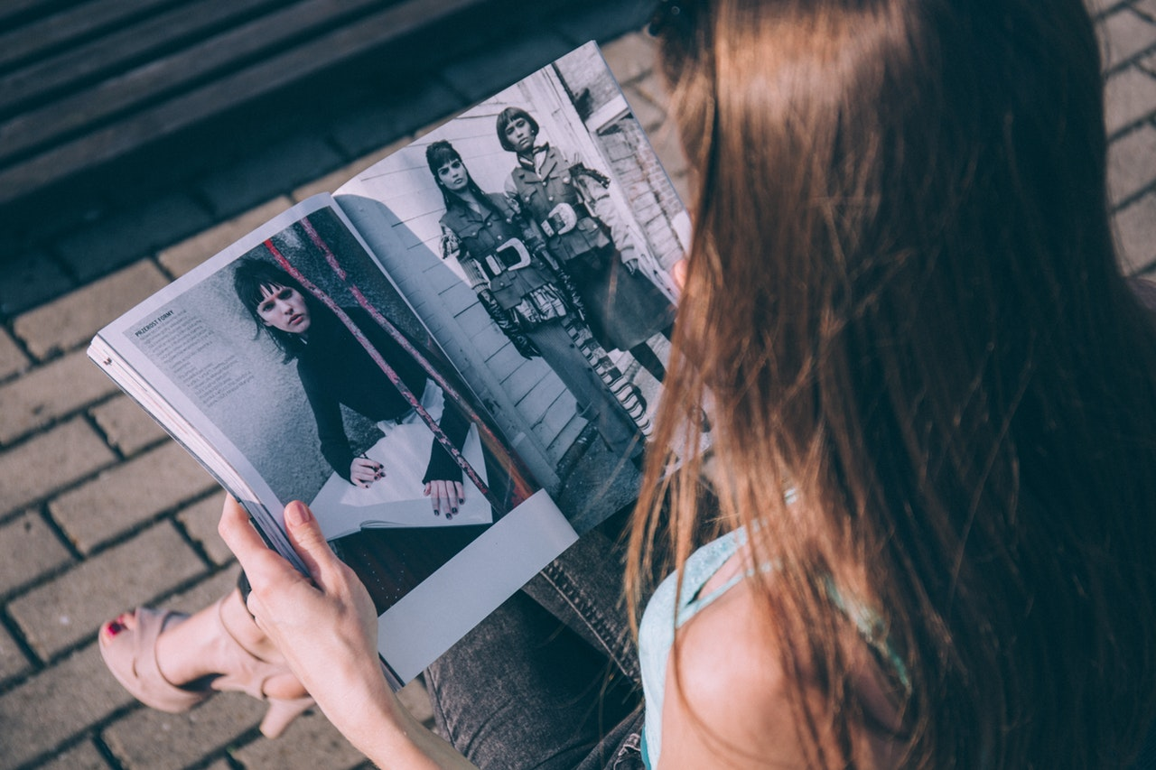 Woman Looking Through Fashion Magazine