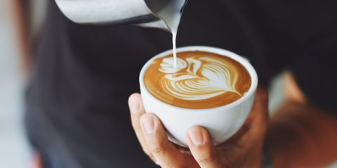 Coffee Being Prepared by a Barista
