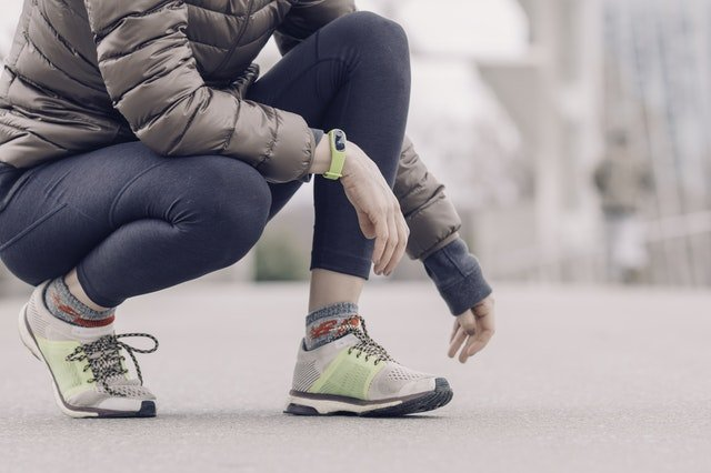 Woman with Jacket and Running Shoes