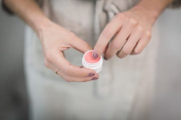 Woman Holding a Lip Balm