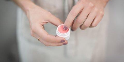Woman Holding a Lip Balm