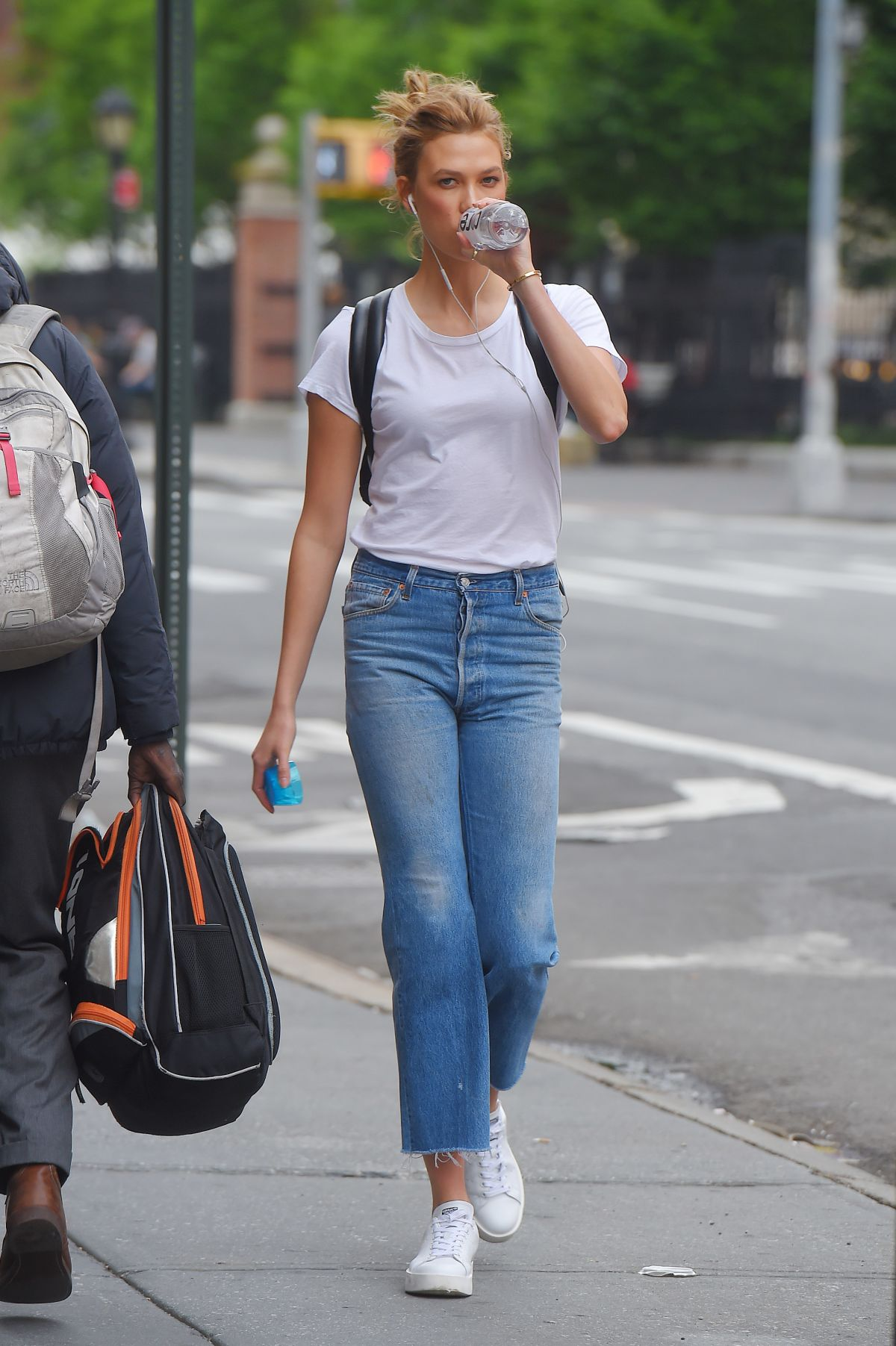 Karlie Kloss Wearing White Tees and Jeans